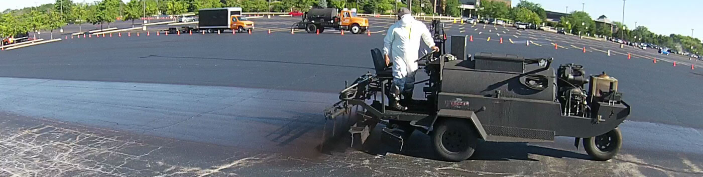 FAQ Featured Image of A&A Paving sealcoating a parking lot